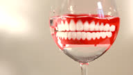 before bed I put the dentures in a glass video