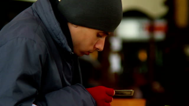 Beggar poor man counting his last money, stolen dollars, eating video