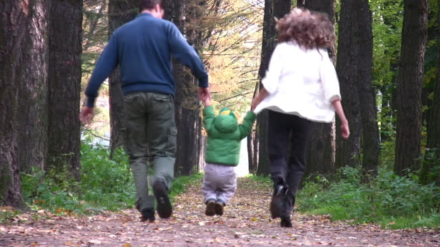 Behind parents with boy in park video