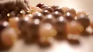 Beige bead necklace macro racking focus shot video