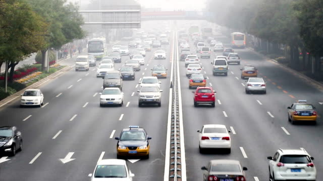 Beijing, China-Oct 25, 2014: In the bad weather,people drive carefully on the road, Beijing, China video