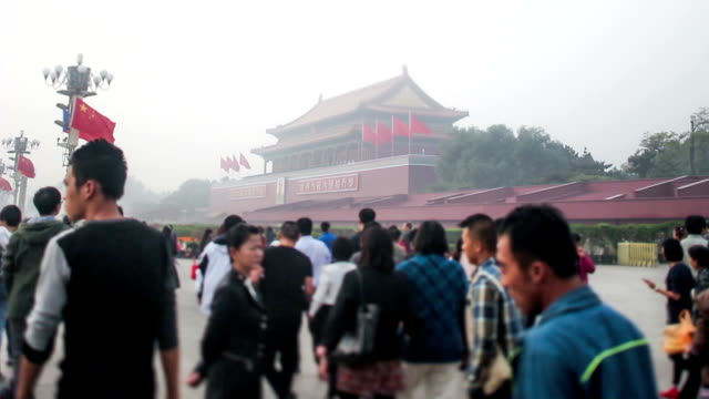 Beijing, China-Oct 25, 2014: People are happy to visit the Tian'anmen Square and take photos in spite of the bad weather, Beijing, China video