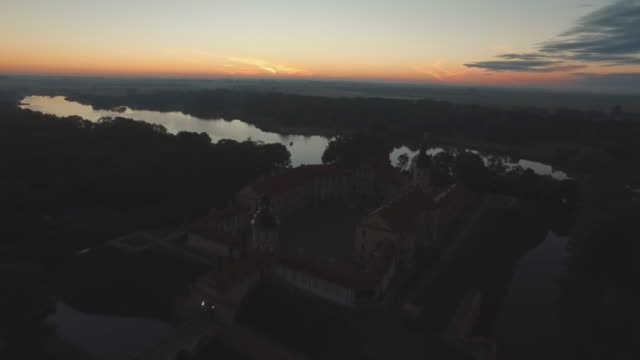 belarus famous forest lake mir castle aerial sunset sky panorama 4k video