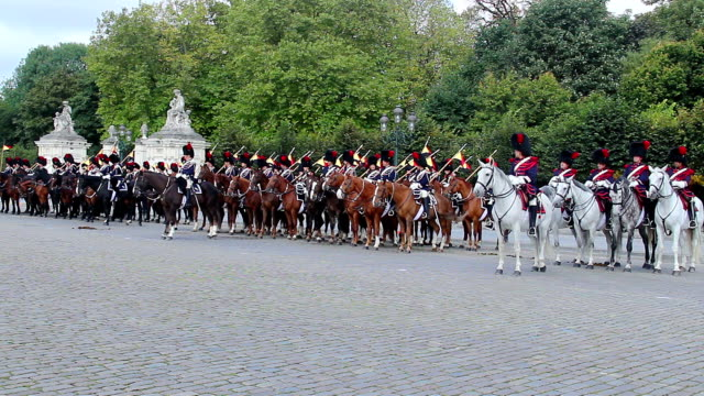Belgian cavalry on parade, tradition uniform royal horse riders. Beautiful shot of Europe, culture and landscapes. Traveling sightseeing, tourist views landmarks of Belgium. World travel, west European trip cityscape, outdoor shot video