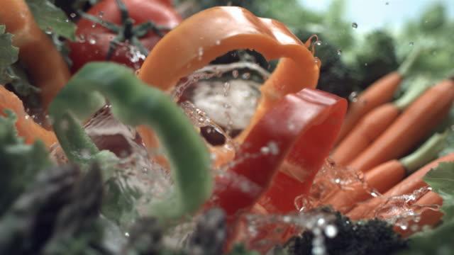 Bell pepper slices splash, slow motion video