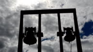 Bells against clouds. video