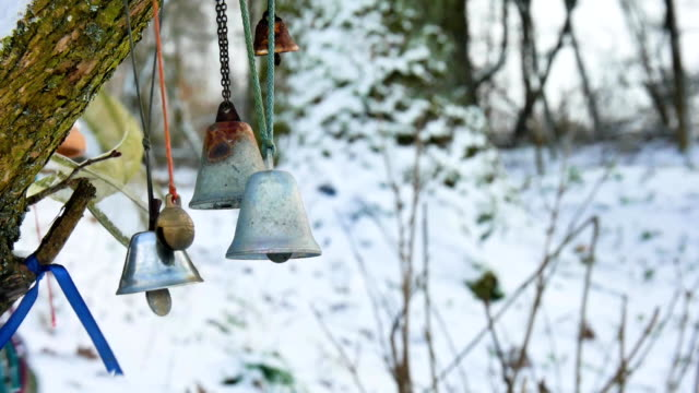 Bells in a winter forest blowing gently in the wind video