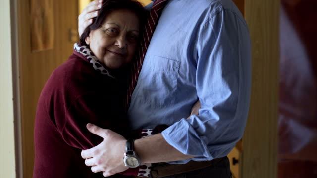 Beloved grandmothe rhug and follow her grandson at work video