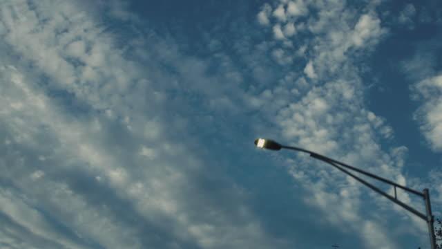 Below View Driving Under Street Lamps Church Steeple video
