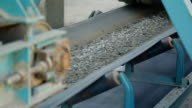 Belt conveyor moves various stone mixtures for further processing video
