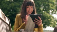 Bench girl tablet close video
