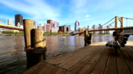 Bench on the wooden pier with downtown on background video