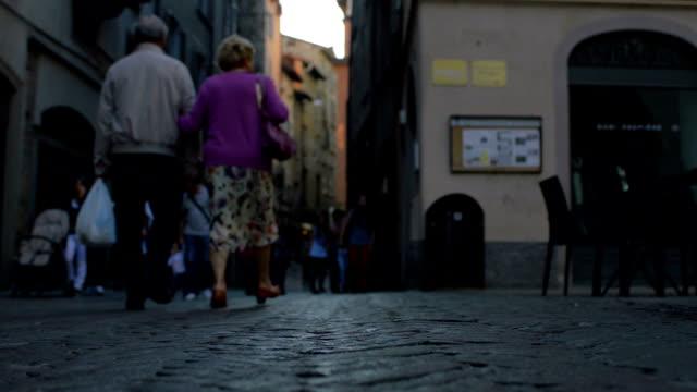 Bergamo Italy old couple walk down street video