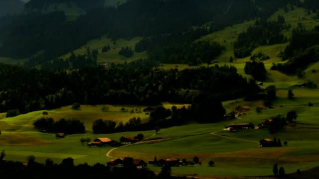 Berner Oberland alpine farms landscape sunbeams time lapse video