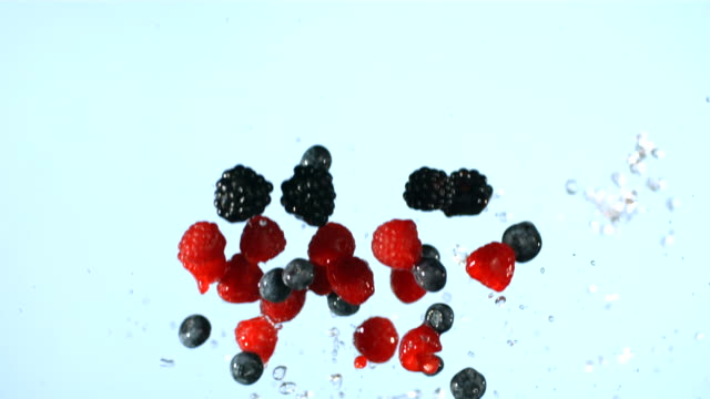 Berries and water splash, slow motion video
