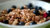 Berries being dropped onto breakfast cereal video