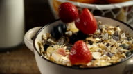 Berries Falling into Bowl with Muesli Cereals video