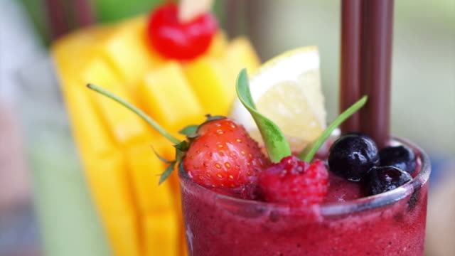 Berries smoothies and mango tropical drink video