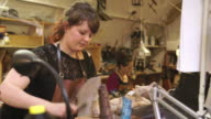 Bespoke Shoemaker Assembling Leather Pieces Together To Make Shoe video