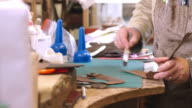 Bespoke Shoemaker Glueing Together Leather Pieces For Shoe video