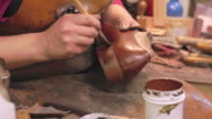 Bespoke Shoemaker Staining And Polishing Leather Of Shoe video