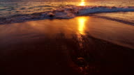 Beutiful Sandy Beach Sunset. Revealing Pan up from Sand to Sunset video