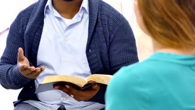 Bible study teacher leads discussion group video