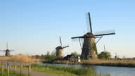 CLOSE UP: Bicycle parking lot next to old authentic traditional Dutch windmills video