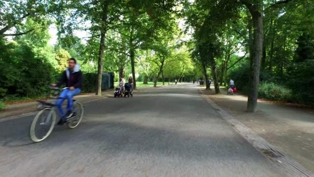 POV: Bicycle ride in Vondelpark Amsterdam video