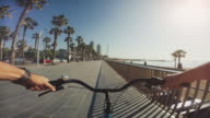 POV bicycle riding at Barceloneta beach in Barcelona, Spain video