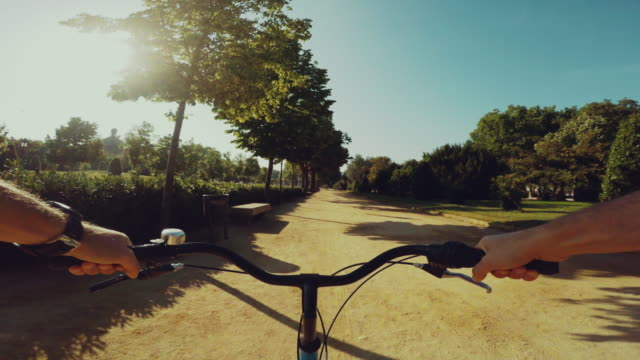 POV bicycle riding in a park in Barcelona video