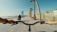 POV bicycle riding in Barcelona summer vacations video