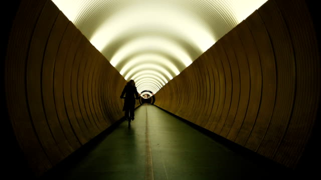 Bicyclist in yellow tunnel video