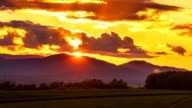 Biei Hill View The Patchwork Road sunset time lapse - Time lapse of the sun setting behind the field hill in biei hokkaido video