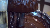 Big and beautiful chocolate fountain, which gives a sweet white and black bitter video