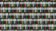 Big archive full of colored binders horizontal dolly shot. FullHD seamless loop able footage video