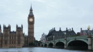 Big Ben and bridge, traffic on bridge at dusk in London video