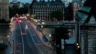 big ben sunrise over westminster bridge tilt up left timelapse video