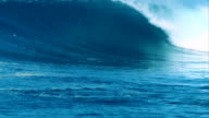 Big blue 20ft wave barreling down reef in remote Indonesia. video