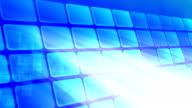 Big blue squares over dark background video