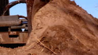 A big bulldozer with large amount of soil video