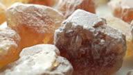 Big crystals of brown sugar, macro dolly shot video