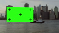 Big Green screen dragging after barge boat NYC video