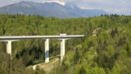 AERIAL: Big highway viaduct leading into the tunnel under the mountain video
