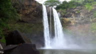 SLOW MOTION: Big majestic waterfall falling down the high rocky wall video