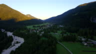 AERIAL: Big mountain valley with small houses and empty roads video
