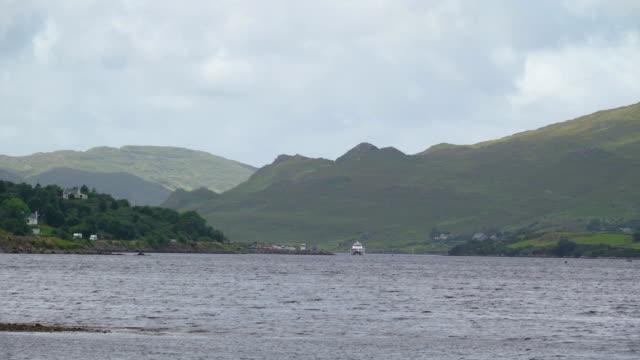 Big ocean with a small boat in Sligo Ireland video