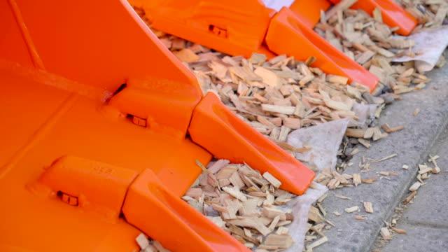 Big orange rakes from a heavy equipment in Ireland video