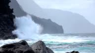 SLOW MOTION: Big powerful wave splashing into majestic rough ocean cliff video