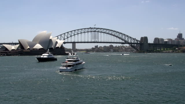 Big private cruise ship in Sydney with Opera house and Harbour bridge at the background video